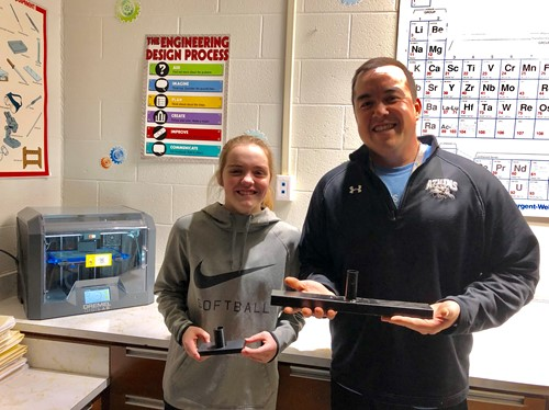 Student and teacher with 3D prints